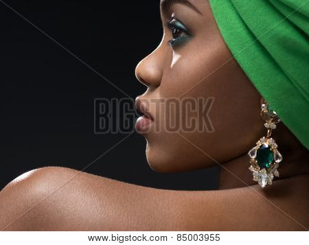 Young african woman in the studio