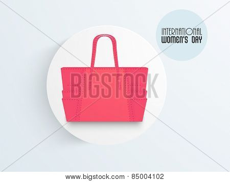 Stylish pink handbag for International Women's Day celebrations.