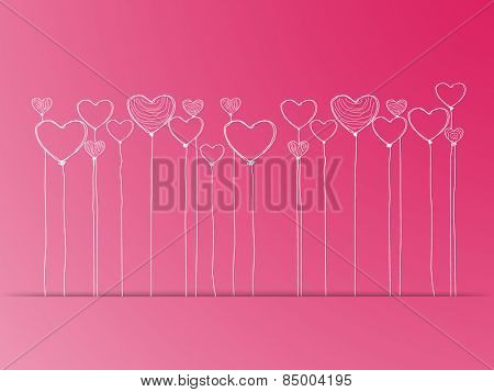 Creative heart shaped balloons on glossy pink background for International Women's Day celebration.