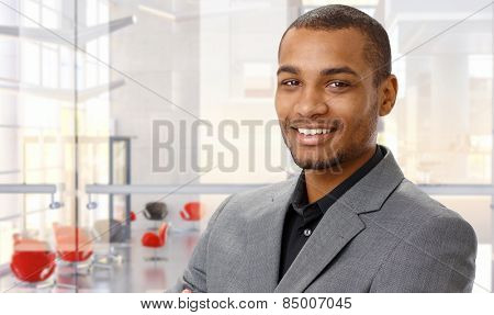 Portrait of happy afro-american businessman at office.