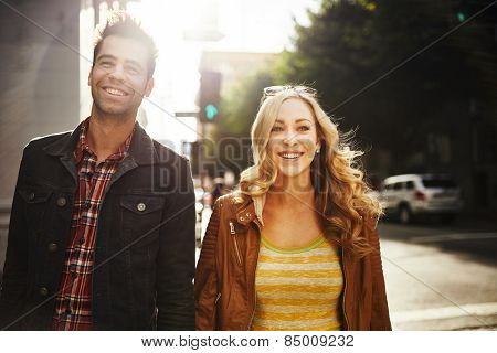 couple taking a walk through down town los angeles usa, shot with lens flare and motion blur