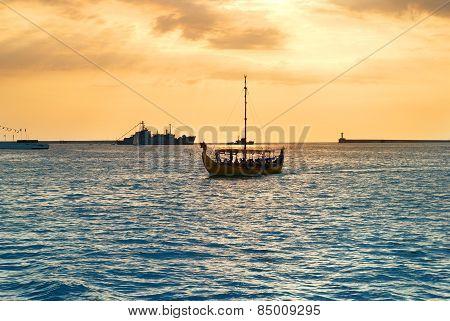Boat Against Sunset