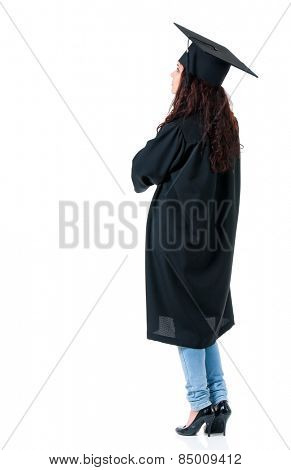 Graduating student girl in an academic gown, isolated on white background