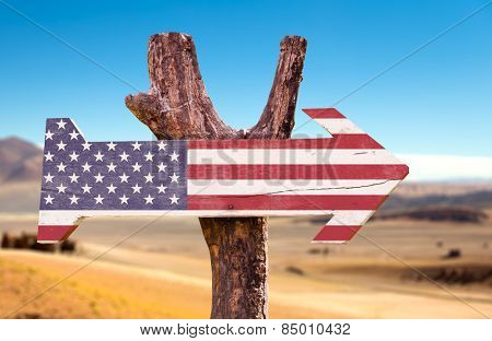 United States Flag wooden sign with a desert background