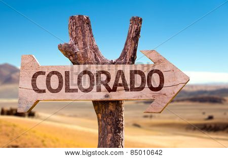 Colorado wooden sign with a desert background