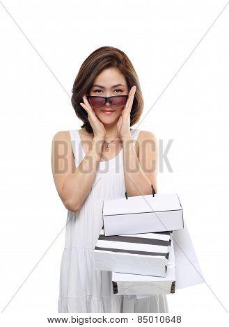 Shopping women asian happy smiling holding shopping bags isolated on white background. Lovely fresh