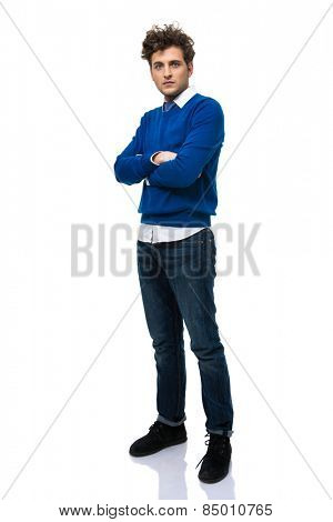 Full length portrait of a handsome man with arms folded over white background