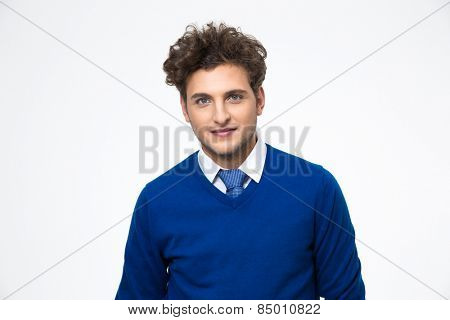 Portrait of a handsome business man standing over gray background