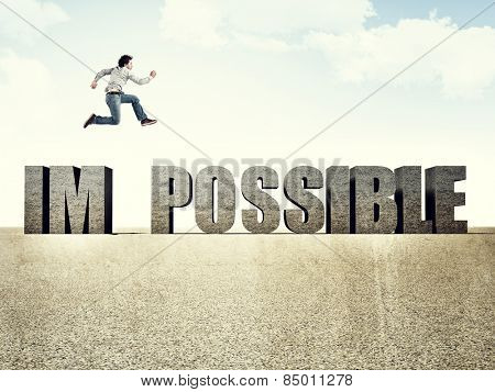 man jump over impossible 3d text