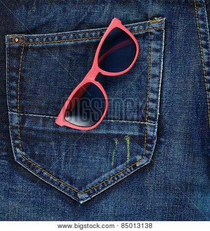 Sun glasses in a back pocket of a jeans