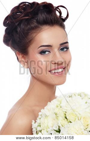 Portrait of young beautiful smiling happy bride with stylish make-up and hairdo over white background