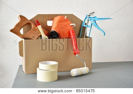 Cardboard toolbox with a set of tools