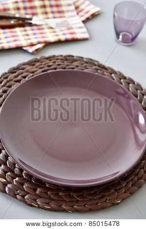 Table setting with straw mat