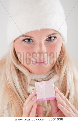 beautiful happy winter woman with christmas present