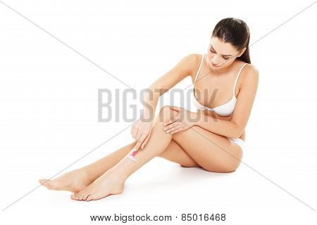 Attractive Young Woman Shaving Her Legs