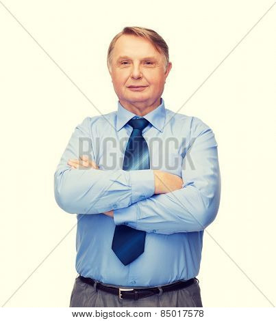 business, office and education concept - smiling buisnessman or teacher