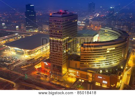 WARSAW, POLAND - 28 FEBRUARY 2014: The Zlote Tarasy complex in the city center of Warsaw at night, Poland. The total area of the building amounts to 205 000 squere meters with over 200 shops.