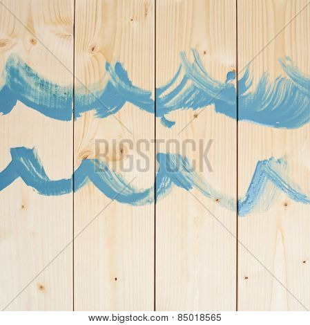 Blue waves drawn over the wood boards