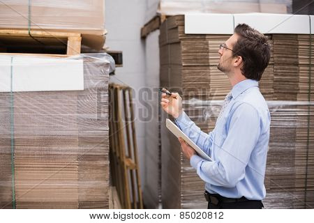 Warehouse manager checking his inventory in the warehouse