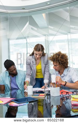 Creative young business people working at office desk
