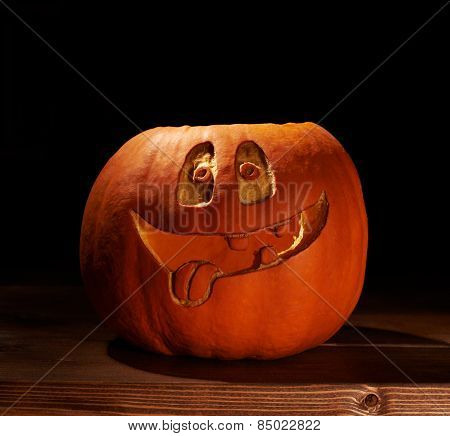 Smiling jack o lantern pumpkin composition