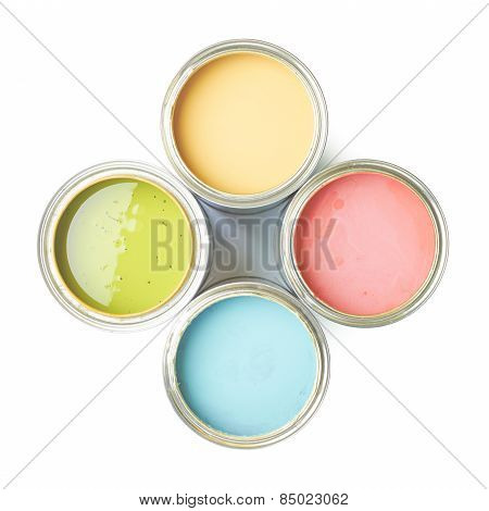 Four cans of paint isolated