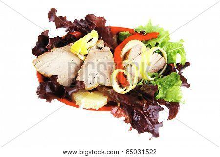 tuna fillet on red porcelain bowl with vegetables