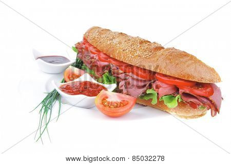 french sandwich : baguette with smoked sausage with sauces and chives isolated over white