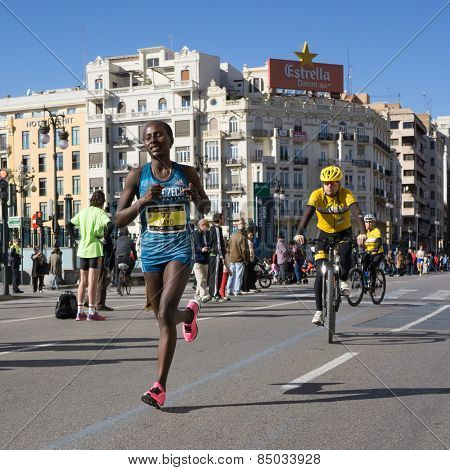 VALENCIA, SPAIN - NOVEMBER 16, 2014: Female marathoner Halima Hussen Kayo of Ethiopia competing in the 2014 Valencia Marathon. Kayo finished in 4th place in the female division with a time of 2:33:26.