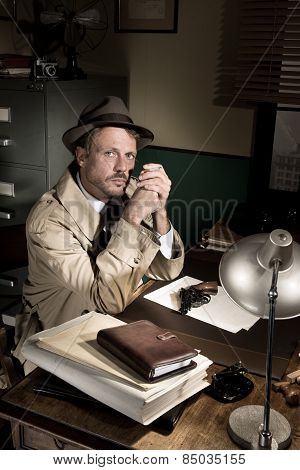 Detective Smoking At Desk