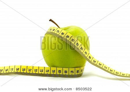 Green Apple isolated on white with measuring tape