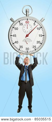 Business man under stress holding stopwatch over his head