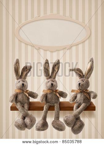 Three hares sitting on the shelf