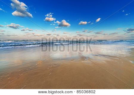 reflection of the sky in the sand beach