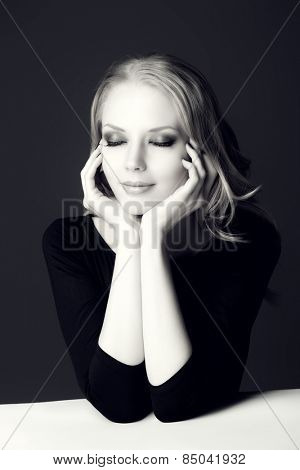 Black-and-white portrait of a beautiful romantic woman smiling at camera. Beauty, fashion. Body care. Skin care.