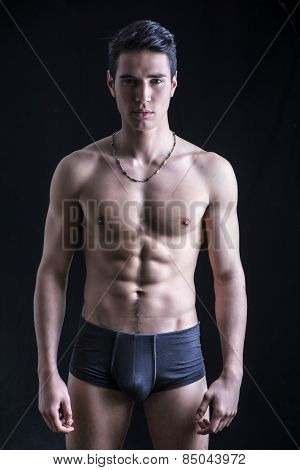 Handsome, Fit Young Man In Underwear Isolated On Black