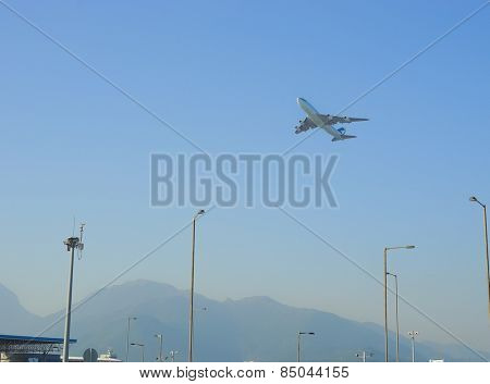 HONG KONG - OCTOBER 06, 2013: Cathay Pacific jet aircraft take-off from Hong Kong International Airport, the world's busiest cargo gateway and one of the world's busiest passenger airports