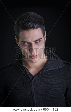 Portrait Of A Young Vampire Man With Black Sweater