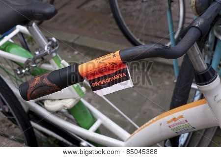 Cycling Inconvenience, Remove Sticker On Bike In Downtown Amsterdam