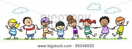 Happy children dancing hand in hand in summer on a meadow