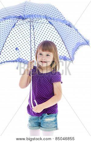 Positive little girl standing under a blue umbrella.