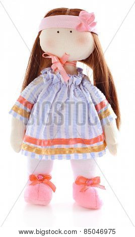 Handmade doll isolated on white