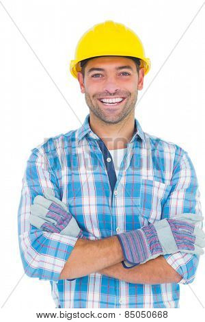 Portrait of smiling manual worker with arms crossed on white background