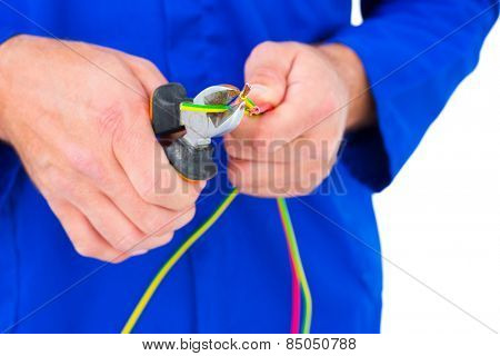 Cropped image of electrician cutting wire with pliers over white background