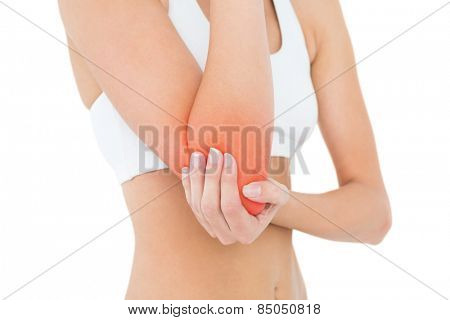 Closeup mid section of a fit young woman with elbow pain over white background