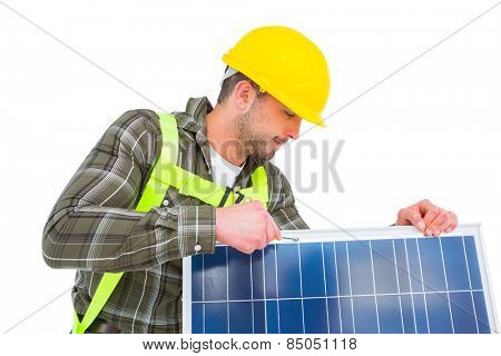 Manual worker tightening solar panel on white background