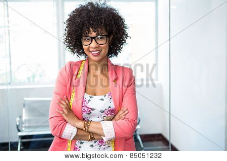 Portrait of confident female fashion designer with arms crossed