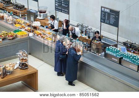 LONDON, UK - NOVEMBER 30, 2014: Cafe in British museum. Interior of main hall, inner yard