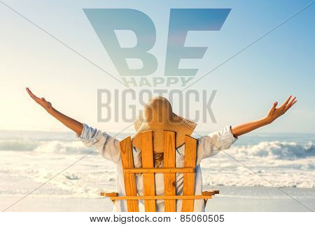 Woman relaxing in deck chair by the sea against be happy
