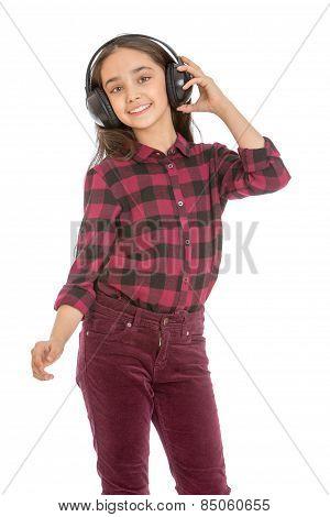 dreaming schoolgirl listening music through headphones